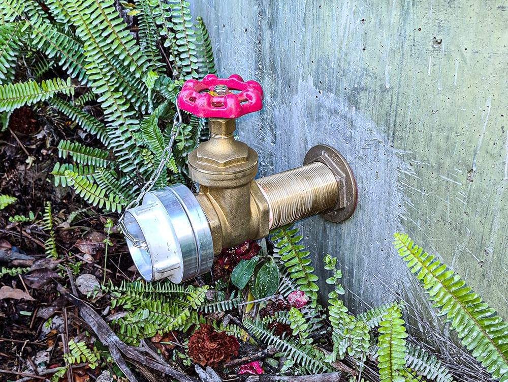 This image shows a Stortz fitting on a water tank that can be used by fire fighters if necessary.
