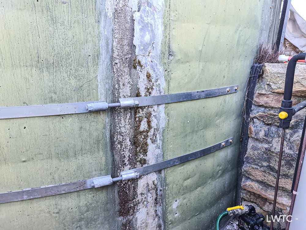 This image shows partial banding of a water tank to reinstate the structural integrity of the water tank.