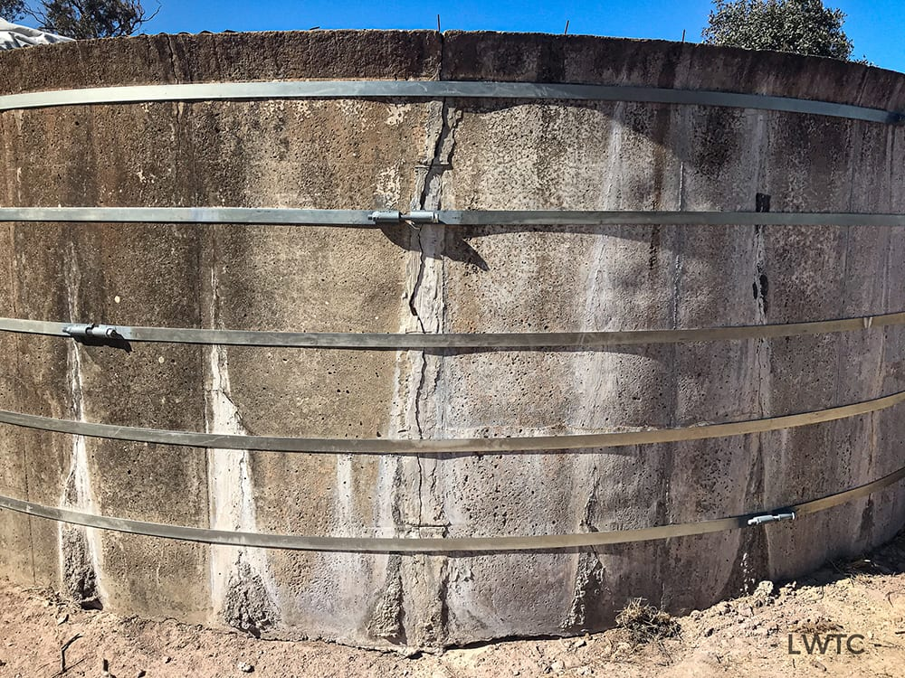 This image shows a concrete water tank with 5 bands installed to reinstate it's structural integrity.