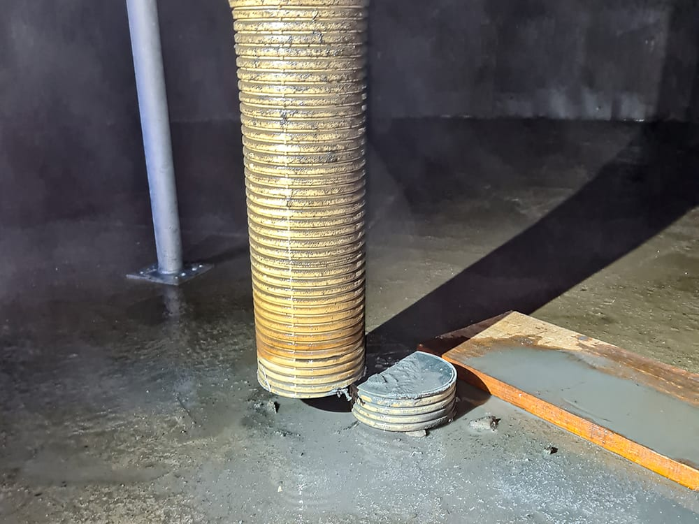 This image shows the pier inside the water tank after it has been cut to allow the liner to be laid out.