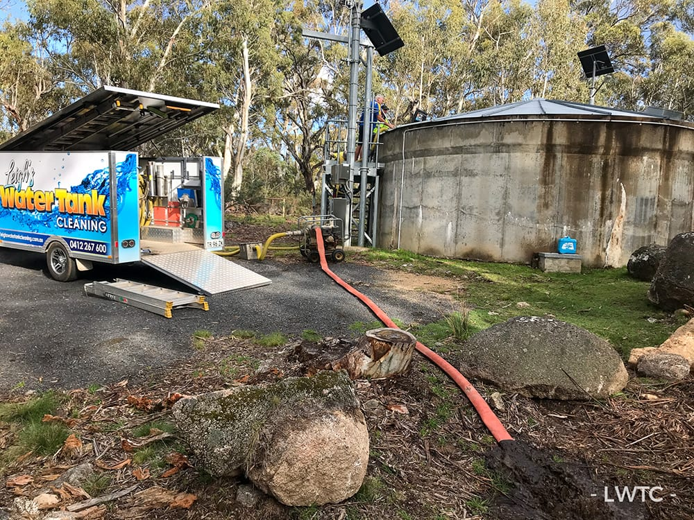This image shows a water tank being cleaned at Sawpit Creek in the Kosciuszko National Park.